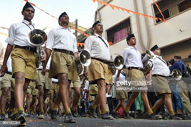 The band of Rashtriya Swayamsevak Sangh take part in the 'Shrung Ghosh Path Sanchalan' by RSS cadets in Bangalore on January 9 2016 The march was...