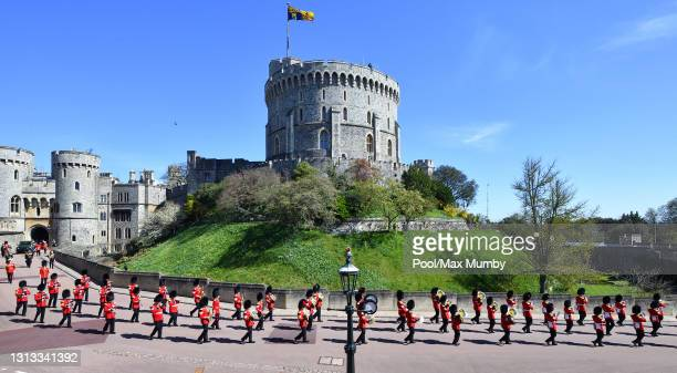 The band of the Grenadier Guards lead Prince Philip, Duke of Edinburgh's funeral procession past the Round Tower to St. George's Chapel, Windsor...