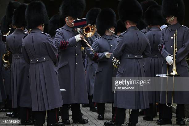 The Band of the Grenadier Guards prepare to lead military personnel as they prepare to march into the Houses of Parliament on January 26 2015 in...