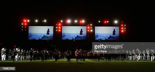 The Band of The Grenadier Guards The Band Bugles of the Rifles The Tongan Royal Corps of Musicians and the Pipe and Drum Band perform during a dress...