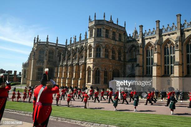 The band of the Grenadier Guards watched by members of the Royal family from the Galilee Porch of St George's Chapel during the funeral of Britain's...
