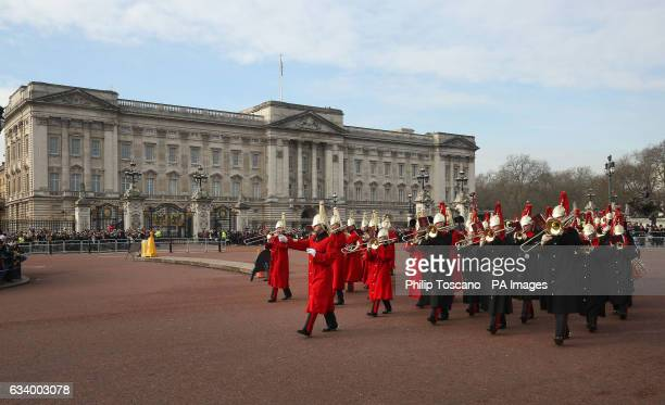 The band of the Household Cavalry outside Buckingham Palace in London during the Changing the Guard ceremony as Queen Elizabeth II has made history...