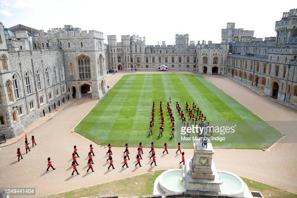 The Band of the Household Division and soldiers of the 1st Battalion Welsh Guards march into the Quadrangle of Windsor Castle ahead of Queen...