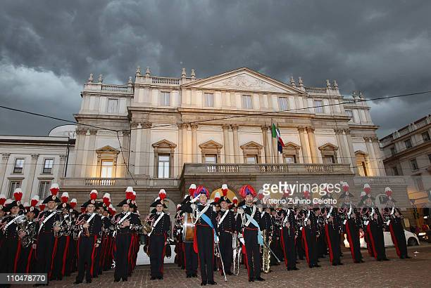 The band of the Italian special police Carabineri pose in Piazza Della Scala after the concert at the Teatro alla Scala on March 19 2011 in Milan...