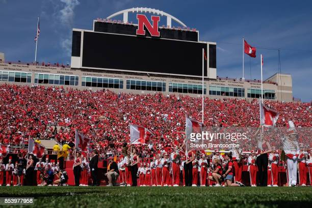 The band of the Nebraska Cornhuskers awaits the arrival of the team before the game against the Rutgers Scarlet Knights at Memorial Stadium on...