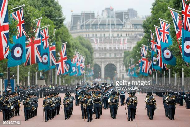 The band of the Royal Air Force parades on the Mall which is bedecked with RAF ensigns towards Buckingham Palace on July 10 2018 during celebrations...