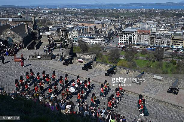 The Band of The Royal Regiment of Scotland play prior to a 21 gun salute to mark the 90th Birthday of Her Majesty The Queen on Mills Mount Battery at...