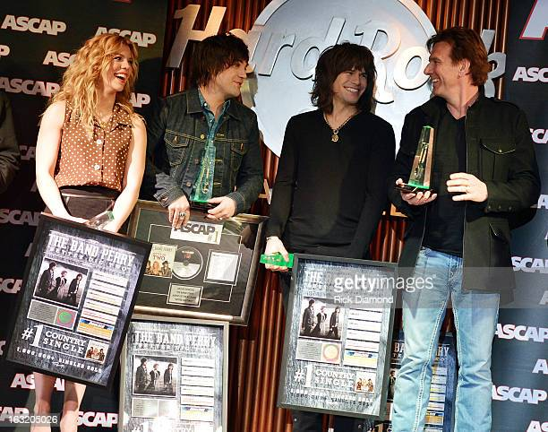 The Band Perry Kimberly Perry Neil Perry Reid Perry ae joined by Producer Dann Huff who attend the Band Perry ASCAP Party for Better Dig Two at Hard...