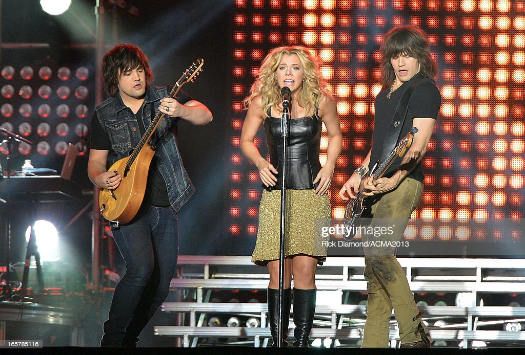 The Band Perry Neil Perry, Kimberly Perry and Reid Perry perform at the ACM Party For A Cause Festival during the 48th Annual Academy of Country Music Awards at the Orleans Arena on April 5, 2013 in Las Vegas, Nevada.