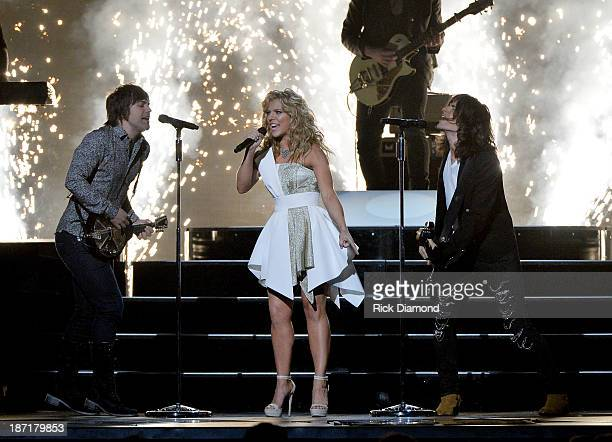The Band Perry performs onstage during the 47th annual CMA Awards at the Bridgestone Arena on November 6 2013 in Nashville Tennessee
