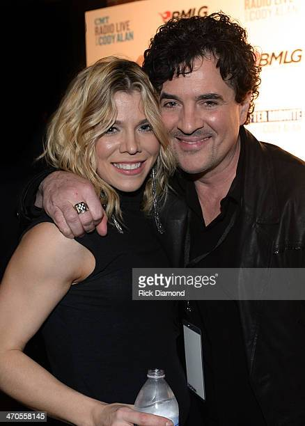 The Band Perry's Kimberly Perry and Big Machine Label Group President CEO Scott Borchetta pause for a photo backstage at the 2014 Big Machine Label...