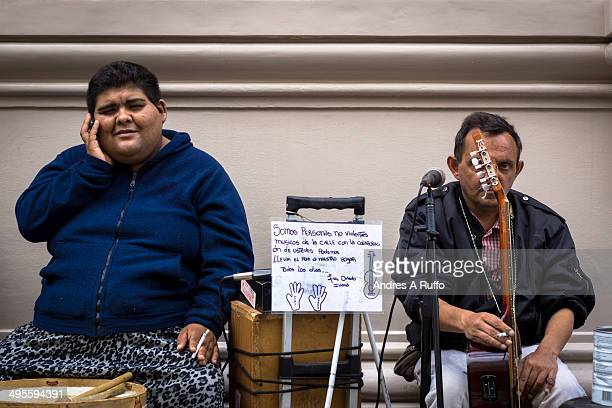 CONTENT] Córdoba Argentina April 23 2014 The band street musicians Luis Oviedo resting after doing a little show in full pedestrian central city of...