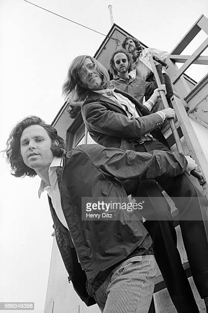 The band The Doors stands on the stairs of a lifeguard tower during a 1969 photo shoot Members are from bottom to top Jim Morrison Ray Manzarek...