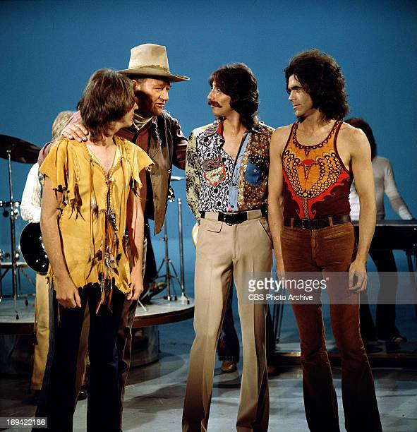 The band Three Dog Night being visited on stage by John Wayne on THE GLEN CAMPBELL GOODTIME HOUR Image dated September 14 1971