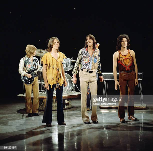 The band, Three Dog Night being visited on stage by John Wayne on THE GLEN CAMPBELL GOODTIME HOUR. Image dated September 14, 1971.