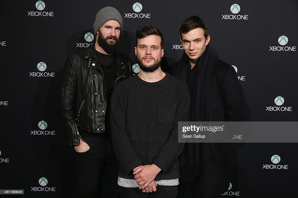 The band White Lies attend the Microsoft Xbox One launch party at the Microsoft Center on November 21, 2013 in Berlin, Germany. Microsoft is launching the new console to compete against the new Sony Playstation 4 ahead of Christmas.