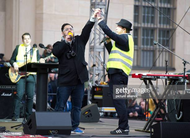 The band Yellow Umbrella performs on stage in front of thousands of people who are taking part in a rally under the motto 'For Dreden for Saxony for...