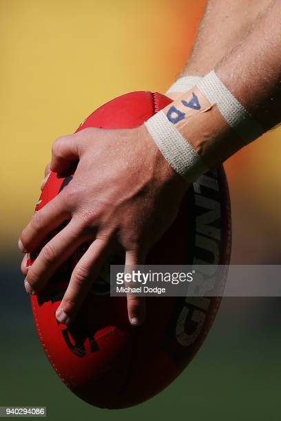 The bandaged wrist of Patrick Cripps of the Blues is seen as he kicks the ball during the round two AFL match between the Carlton Blues and the Gold...