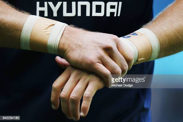 The bandaged wrists of Patrick Cripps of the Blues is seen during the round two AFL match between the Carlton Blues and the Gold Coast Suns at Etihad...