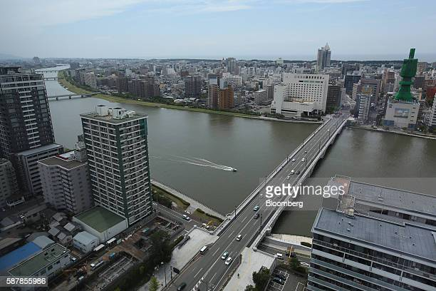 The Bandai Bridge stands across the Shinano River in Niigata Niigata Prefecture Japan on Wednesday Aug 3 2016 In attempting to hit a 2 percent annual...