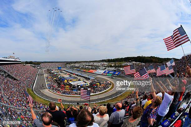 The Bandit Flight team performs a flyover during prerace ceremonies for the NASCAR Sprint Cup Series Goody's Fast Relief 500 at Martinsville Speedway...