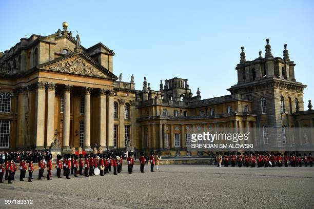 The bands of the Scots, Irish and Welsh Guards are gathered in the Great Court at Blenheim Palace, west of London, on July 12 to welcome US President...