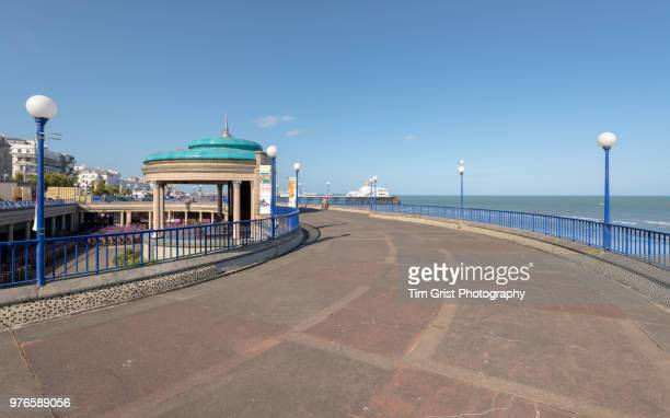 the bandstand, promenade and eastbourne pier - eastbourne stock photos and pictures