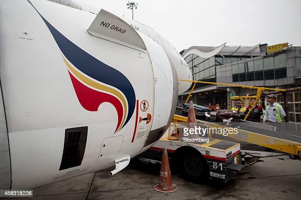 The Bangkok Airways Co logo is displayed on the engine of an Airbus SAS A319 aircraft at Hong Kong International Airport in Hong Kong China on Monday...