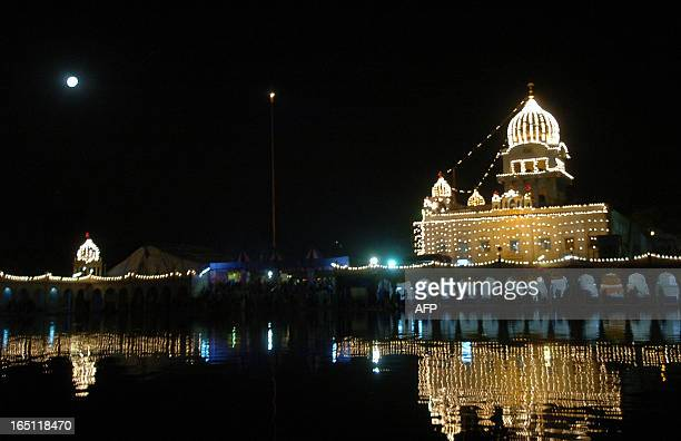 The Bangla Sahib Gurdwara is lit up in New Delhi 15 November 2005 to mark the 536th birth anniversary of Guru Nanak Dev the founder of Sikhism Sikhs...
