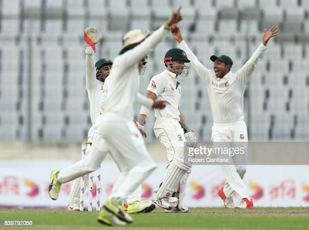 The Bangladesh fielders appeal unsuccessfully for the wicket of David Warner of Australia during day one of the First Test match between Bangladesh...