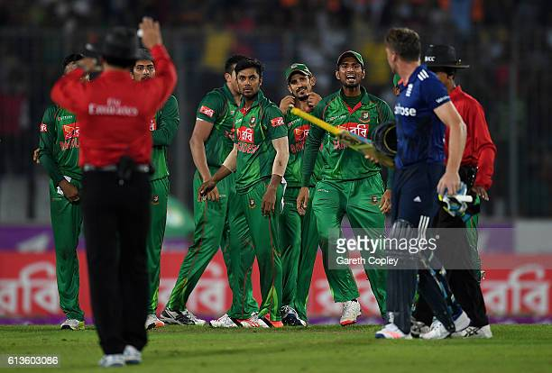 The Bangladesh fielders send off Jos Buttler as he leaves the field as umpires Aleem Dar and Sharfuddoula step in during the 2nd One Day...