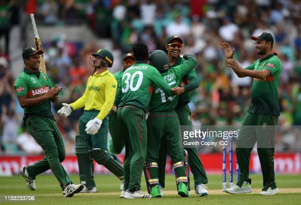 The Bangladesh side celebrate as QUinton De Kock is run out by Mushfiqur Rahim of Bangladesh during the Group Stage match of the ICC Cricket World...