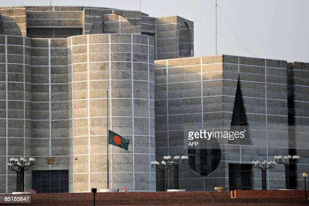 The Bangladeshi national flag is seen at halfmast in front of the Bangladesh National parliament building fly in Dhaka on February 28 as the...