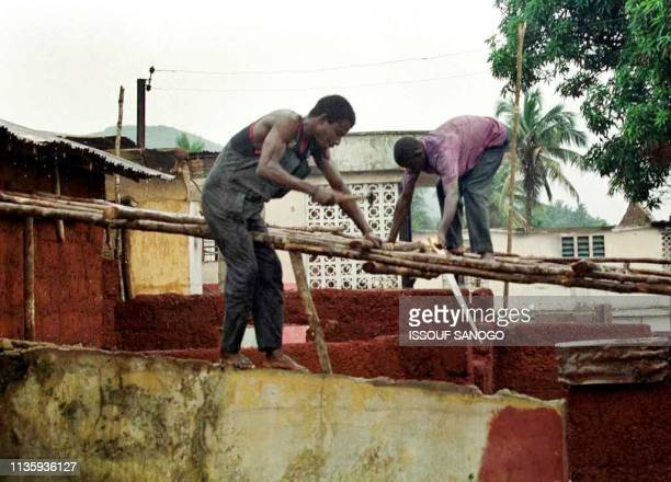 The Bangura family starts to rebuild their house 09 July 1999 in Freetown which was reportedly destroyed by RUF rebels A peace deal was reached 07...