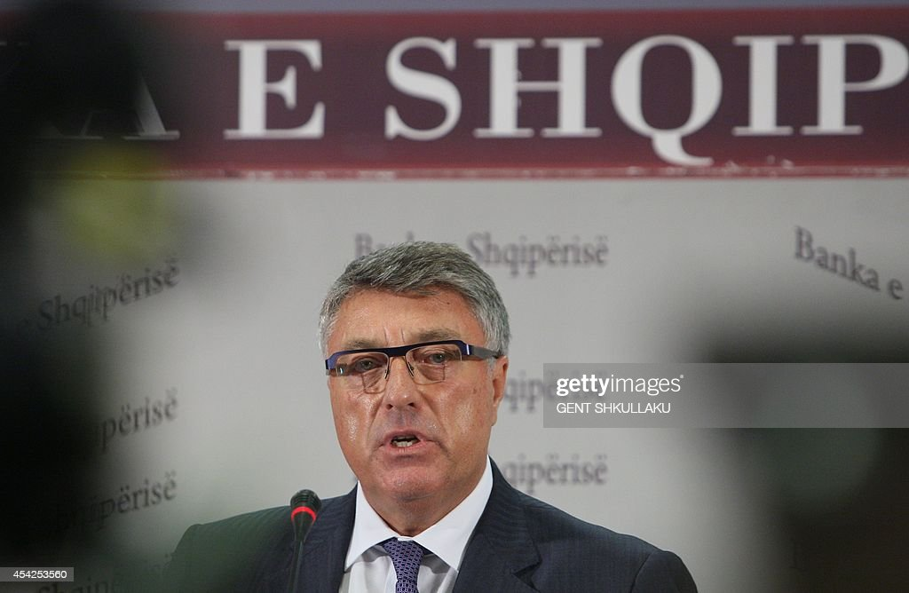 The Bank of Albania Governor Ardian Fullani speaks during a press conference in Tirana on August 27, 2014. Governor Fullani and the Supervisory Board of the Bank of Albania have come under a lot of public pressure to take responsibility over the theft of Lek 713m (around 5 million euros or 6.75 million USD) from its vault by an employee, made public in July.