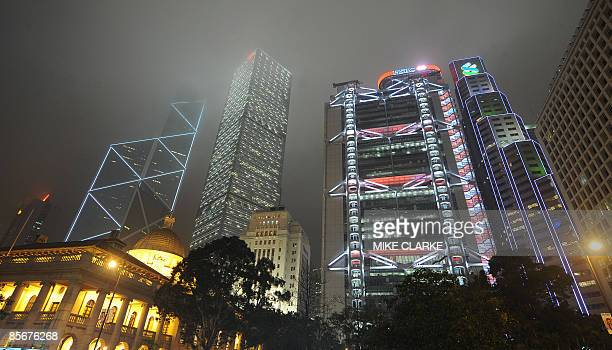 The Bank of China building the Cheung Kong Centre the HSBC Building and the Standard Chartered Bank building are lit up as they tower over the...