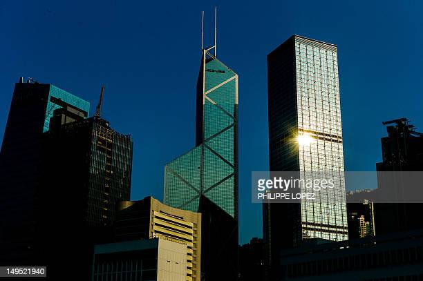 The Bank of China tower and Cheung Kong center is seen in Hong Kong on July 30 2012 AFP PHOTO / Philippe Lopez