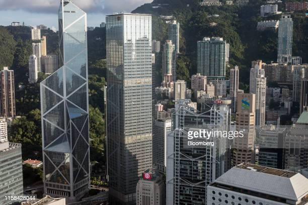 The Bank of China Tower from left the Cheung Kong Center building the HSBC Holdings Plc headquarters building and the Standard Chartered Bank...