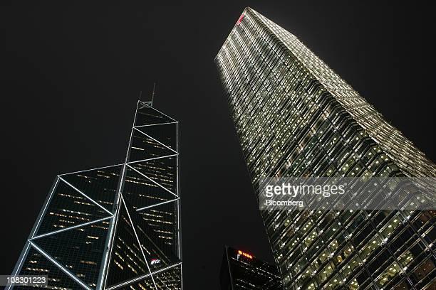 The Bank of China Tower left Citibank Plaza centre and the Cheung Kong Center right are illuminated at night in Hong Kong China on Monday Jan 24 2011...