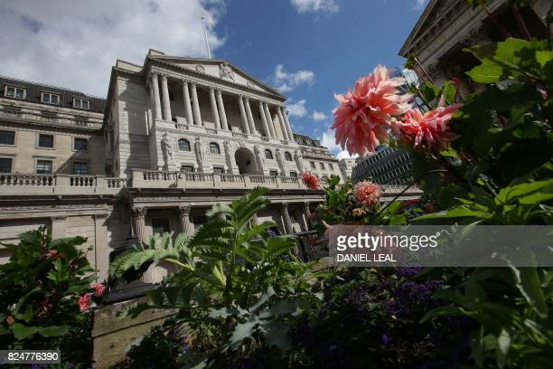 The Bank of England is pictured beyond flowers outside the Royal Exchange in the City of London on July 31 2017 Lastminute talks with staff at the...