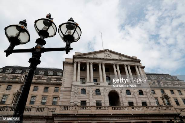 The Bank of England is pictured in the City of London on May 11 ahead of the central bank's quarterly Inflation Report press conference The Bank of...