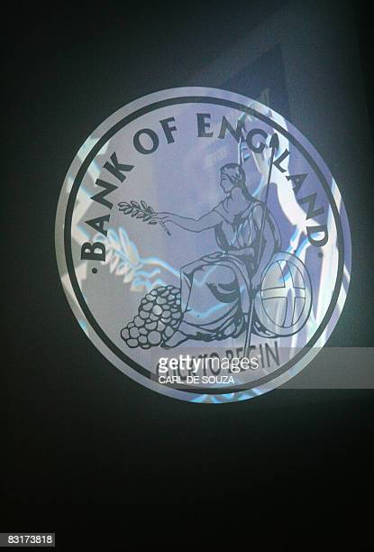 The Bank of England logo is illuminated at the Bank of England Museum in London on October 7 2008 The Bank of England on Wednesday October 8...