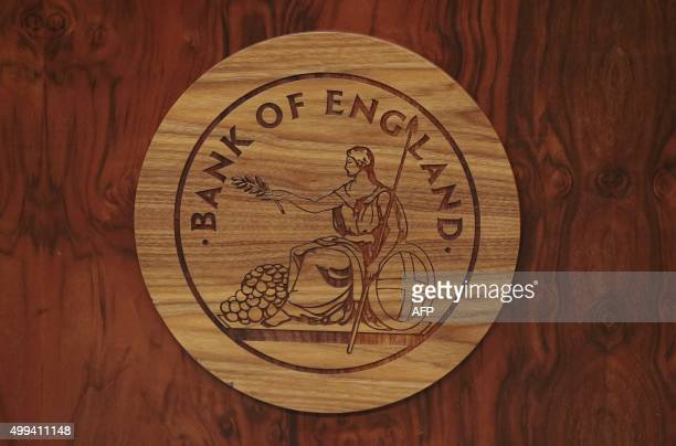 The Bank of England logo is seen on a desk during a news conference at the Bank of England in London on December 1 2015 Britain's seven top lenders...