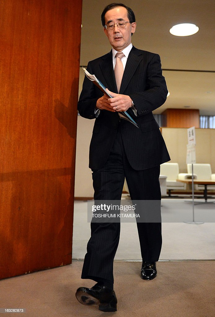 The Bank of Japan (BOJ) governor Masaaki Shirakawa arrives at a press conference in Tokyo on March 7, 2013. BOJ wrapped up its last policy meeting under governor Shirakawa, making way for a new leadership team that could herald a new era for the central bank.