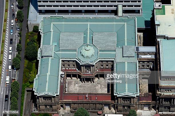 The Bank of Japan headquarters stands in this aerial photograph taken in Tokyo, Japan, on Wednesday, June 24, 2015. The Abe administration aims to...