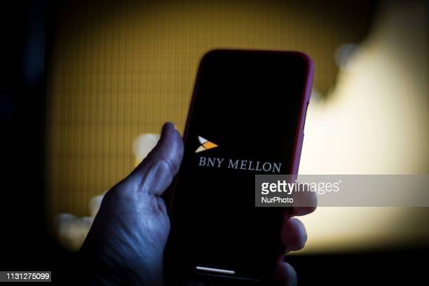 The Bank of New York Melleon logo is seen on a mobile device in this photo illustration on March 17 in Warsaw Poland BNY Mellon is one of the ten...