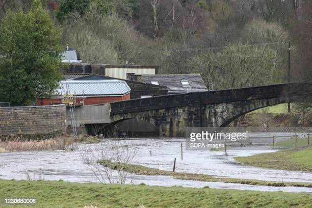 The banks of the River Calder overflow onto saturated ground near Mytholmroyd in West Yorkshire. Residents are preparing for potential flooding as...
