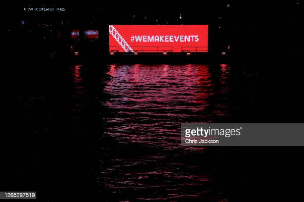 The banks of The River Thames are lit up in red as part of the#WeMakeEvents 'Throw Us a Line Campaign' on August 11, 2020 in London, England. Venues...
