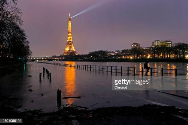 The banks of the Seine river are submerged by flood water near the Eiffel Tower on February 08, 2021 in Paris, France. Heavy rains caused the level...