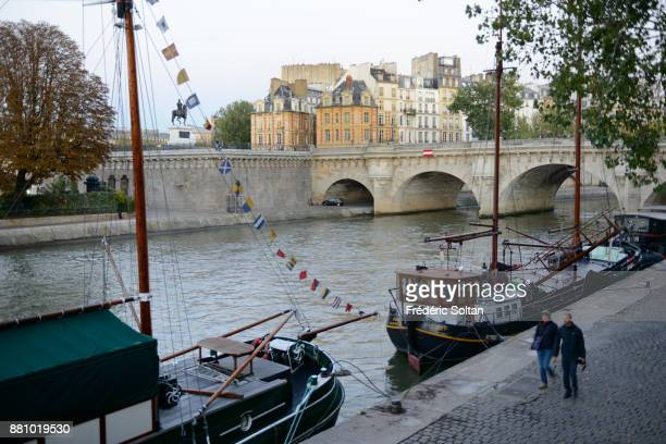 The banks of the Seine river with the 'Pont Neuf' background in Paris on October 20 2015 in Paris France